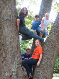 Now all the youth are in the tree together smiling.